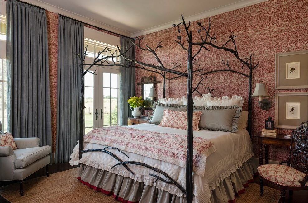 Wrought-iron Bed as a Stylish and Functional Interior Element. Tree trunks imitating metal canopy creates the sense of forest in the Classic styled room