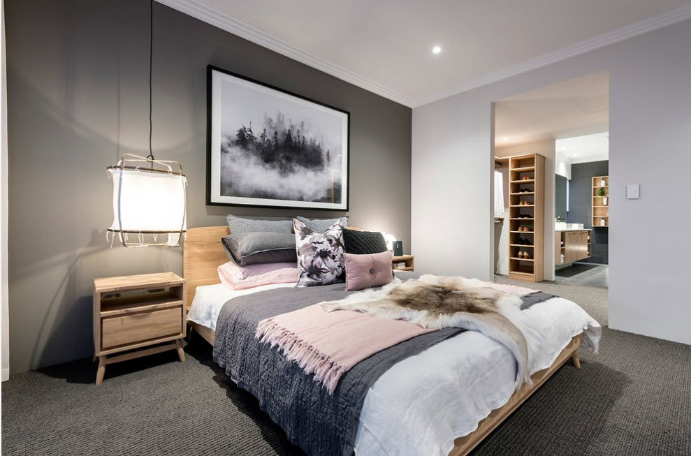 Gray accent wall in the modern design for the bedroom with
