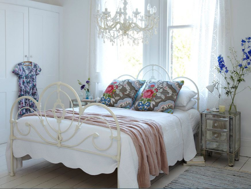 Wrought-iron Bed as a Stylish and Functional Interior Element. Classic lightness for full of light room