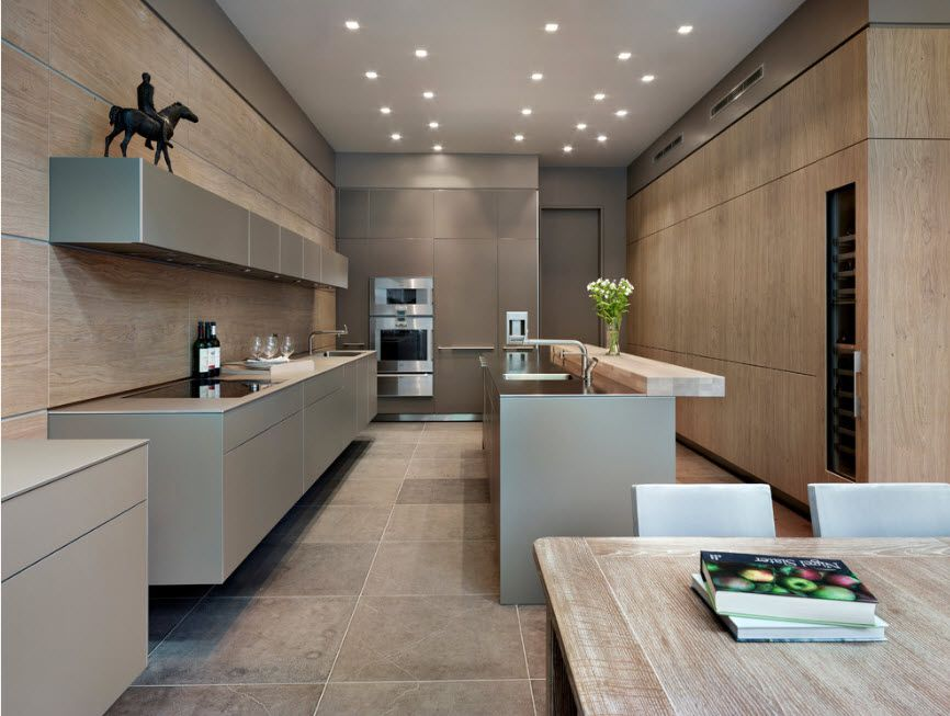 Myriads of lighting fixtures in the gray toned kitchen with wooden trimming