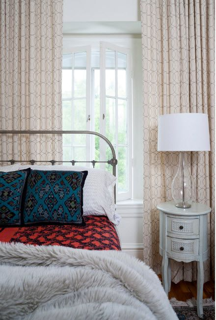 Wrought-iron Bed as a Stylish and Functional Interior Element. Classic atmosphere in the room with vintage elements