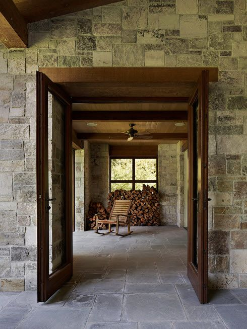The Use of Decorative Stone for Modern Interiors' Finishing.  Entrance to the suburb house all in natural imitating material