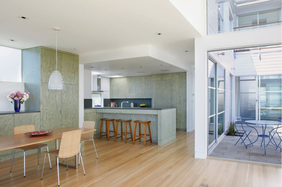 Light olive tone to highlight the kitchen island in the studio apartment