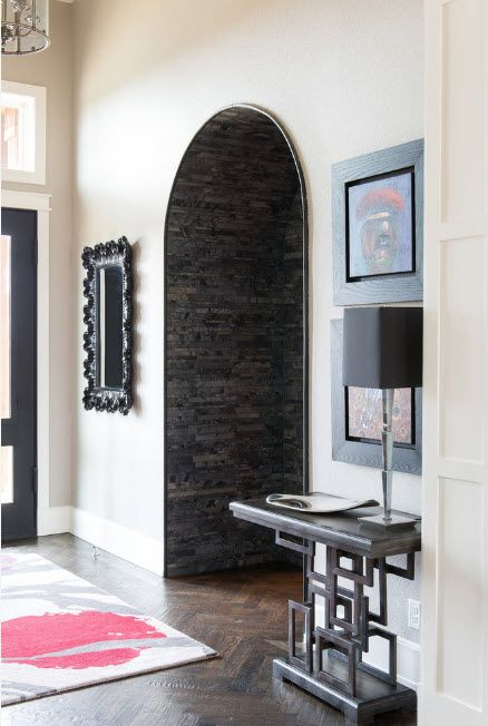 The Use of Decorative Stone for Modern Interiors' Finishing. Arch in dark gray slabs