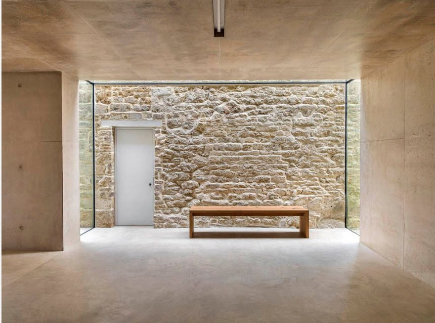 The Use of Decorative Stone for Modern Interiors' Finishing. Unexpected entrance design with rock trimmed wall fragment