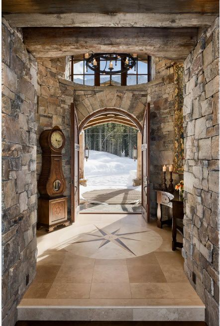 The Use of Decorative Stone for Modern Interiors' Finishing.  Gorgeous imitation of gray stone for the large house resembling the medieval castle