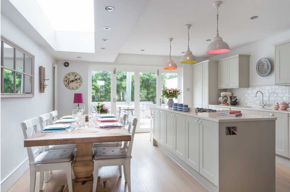 Classic kitchen set with perky colorful lampshades over the islnd's countertop
