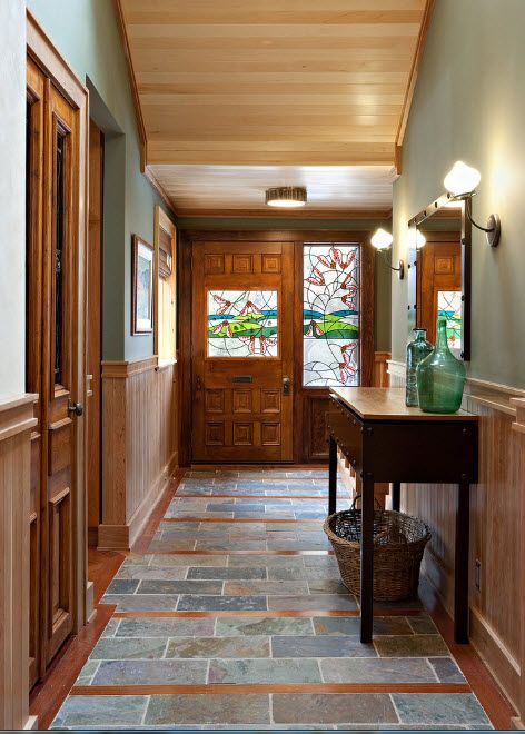 Multicoored stone finish of floor for the Classic designed hall of the cottage