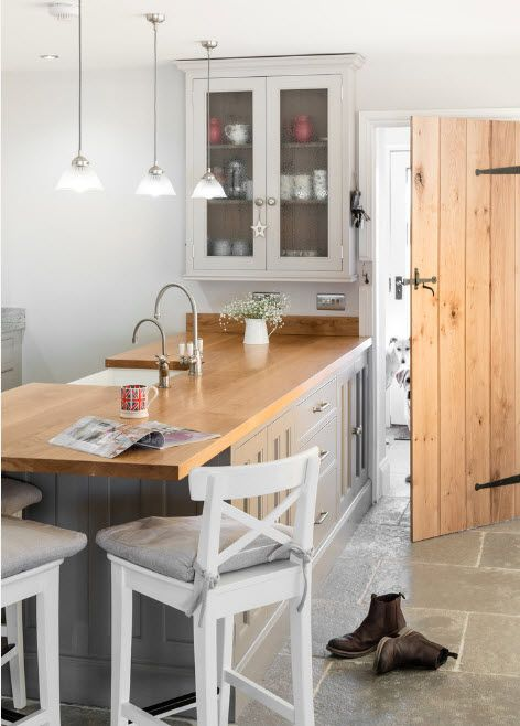 Bleached Oak Color in Modern Interior Design. Light wooden countertop and door into white kitchen