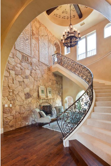 The Use of Decorative Stone for Modern Interiors' Finishing. Gorgeous example of Gregorian style with forged stairway rails and stone walls