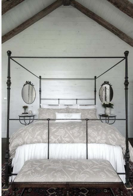 Wrought-iron Bed as a Stylish and Functional Interior Element. Peculiar form of the metal canopy for royal bed decorated with two mirrors
