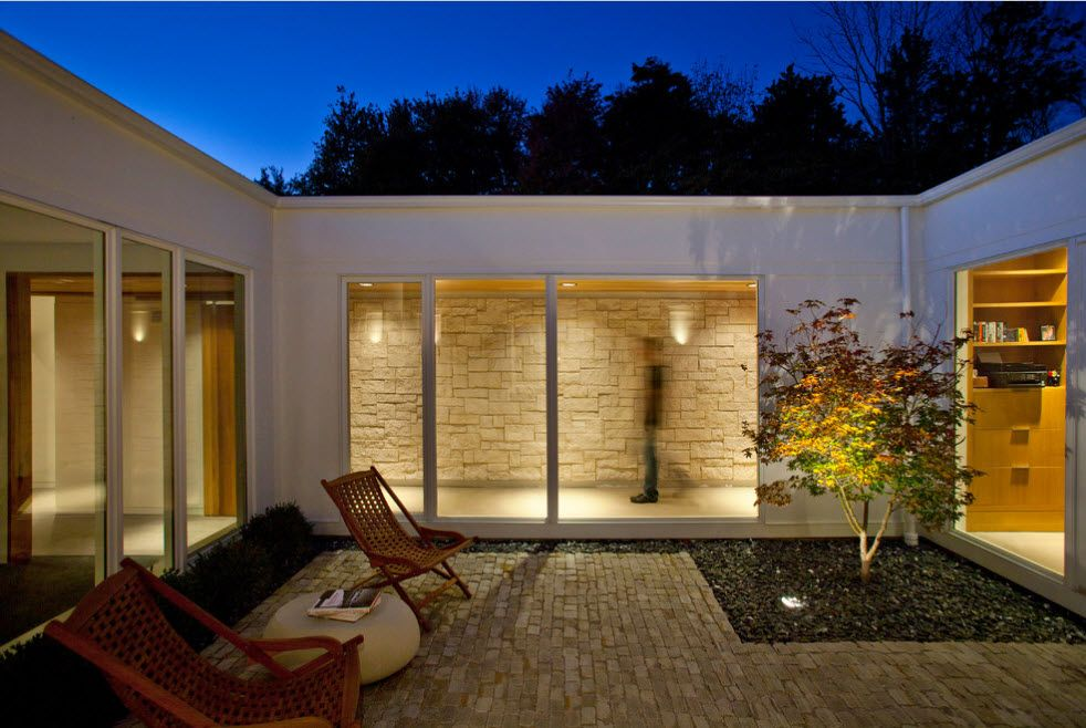 Typical modern hi-tech styled cottage with boxed architecture and stone wall finishing