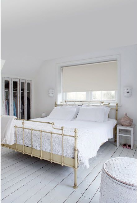 Light painted walls and creamy bed frame