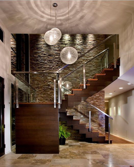 The Use of Decorative Stone for Modern Interiors' Finishing. Gray accent wall at the hi-tech multilevel apartment