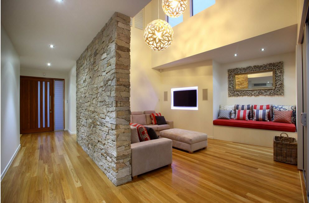 The Use of Decorative Stone for Modern Interiors' Finishing. Zoning interior wall decorated