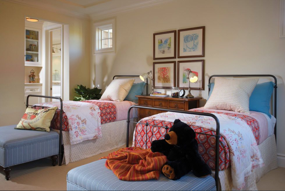 Wrought-iron Bed as a Stylish and Functional Interior Element. Two beds in the room with nice crimson linens