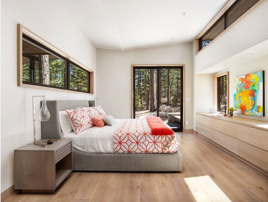 Platform bed for the modern spacious master bedroom full of light and storage systems