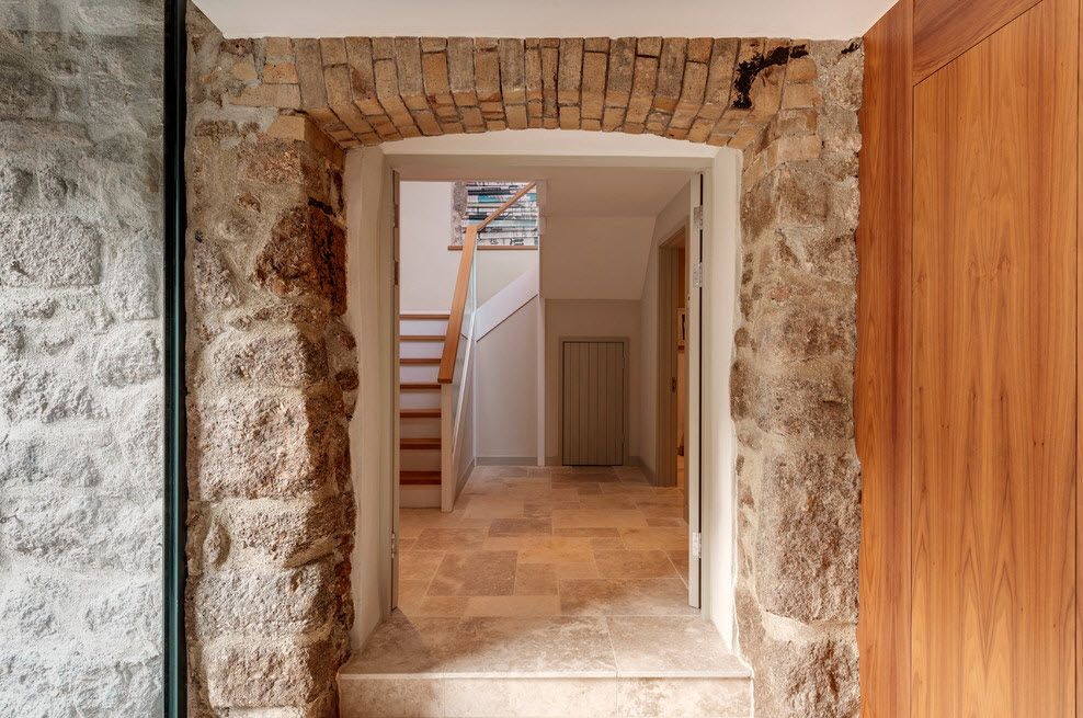 The Use of Decorative Stone for Modern Interiors' Finishing. Interior arch decorated with different natural imitating materials