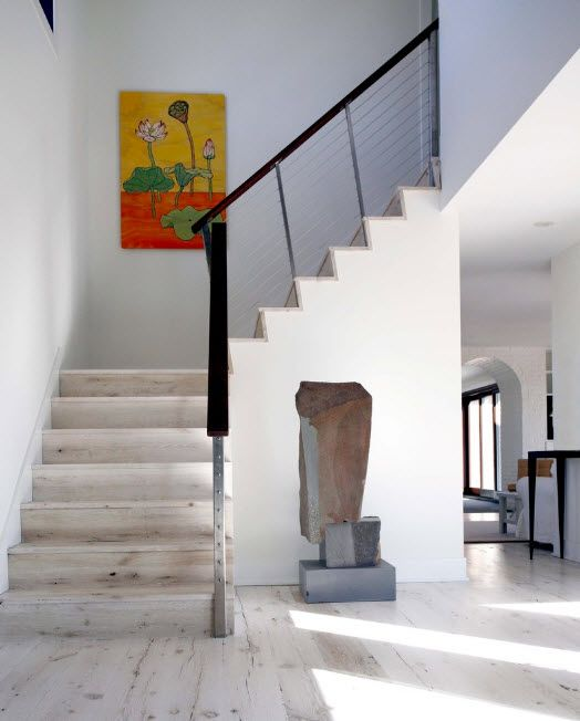 Bleached Oak Color in Modern Interior Design. Stairs in the private house styled in white