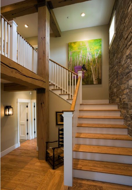 Wooden stairs and granite trimmed wall for the modern Casual interior
