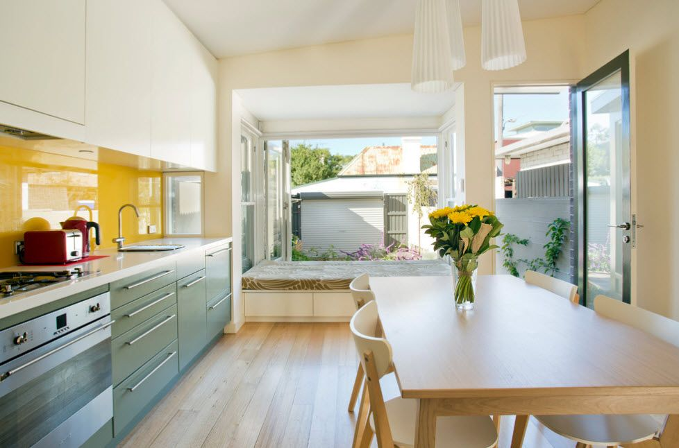 Gorgeous complex design for the modern private house's kitchen with smooth paneled kitchen facades
