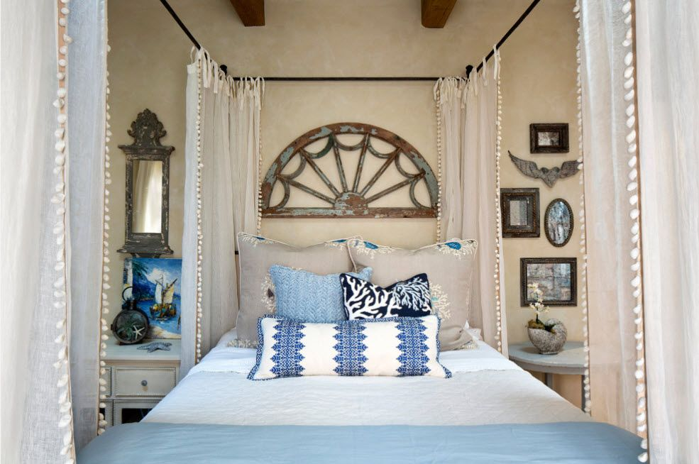 Wrought-iron Bed as a Stylish and Functional Interior Element. Hand-fan-like decoration of the headboard wall at the metal canopy