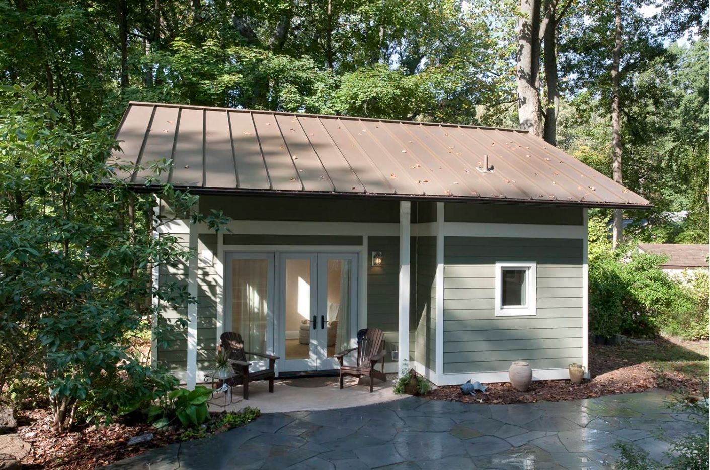 Modern Designs for Tiny Homes. Plastic siding, metal roof and a porch