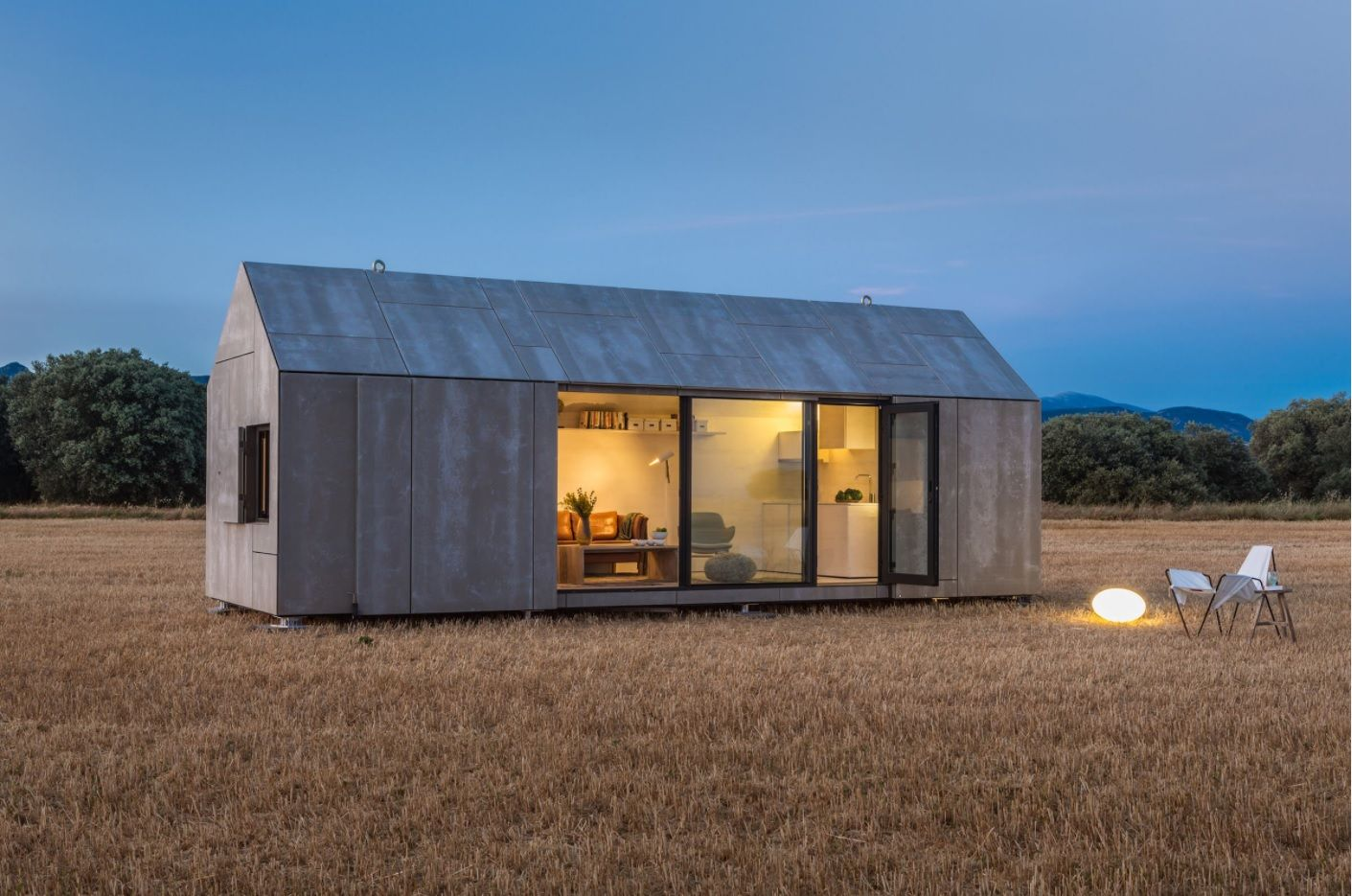 Modern Designs for Tiny Homes. Unified unusual hi-tech design for monolithic looking small cottage
