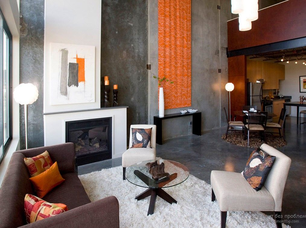 Orange decoration in the large private house's living room in dark tones