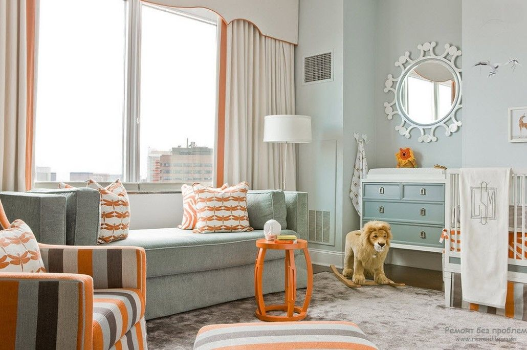 Orange decoration as a touch in the light fresh Modern deisgn of the living
