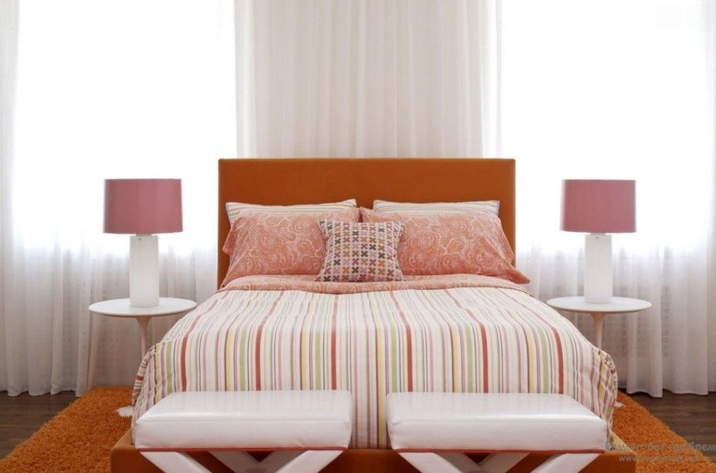 Creamy colored bedroom with orange carpet