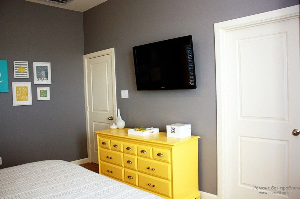Gray bedroom with vivid yellow Classic cabinet under TV