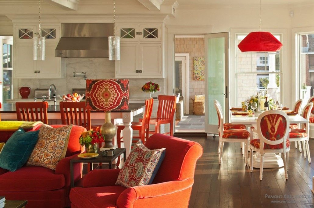 Orange color of furniture in the Classic designed open space in the private cottage