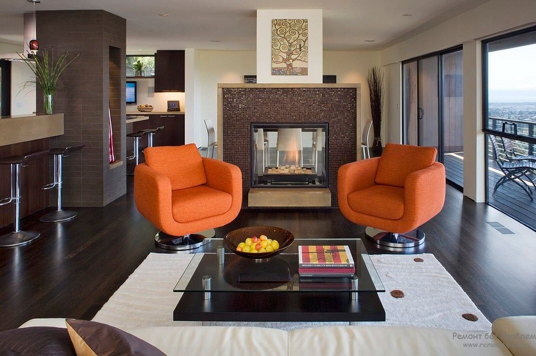 Business atmosphere in the living room with two swivel orange armchairs