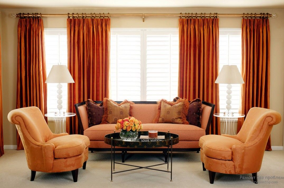 Orange Color Interior Decoration Real Photo Examples. Deep orange curtains and the mild hue of the furniture
