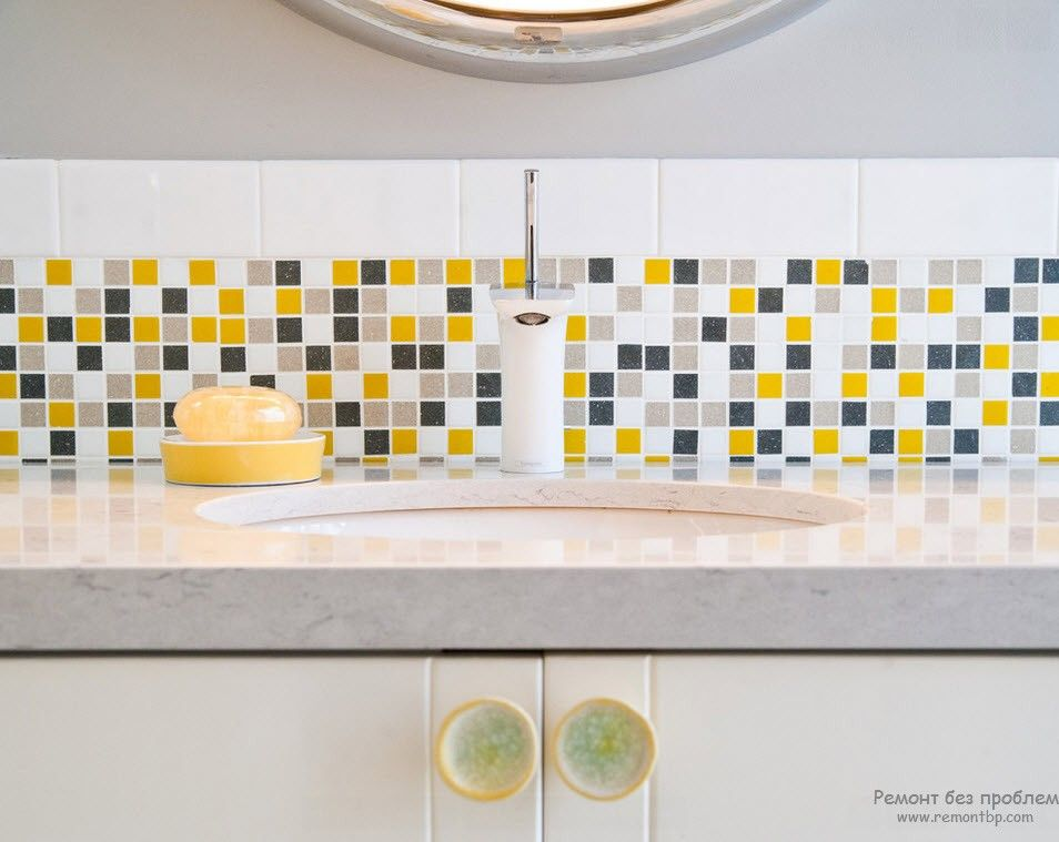 Mosaic splashback and the granite countertop