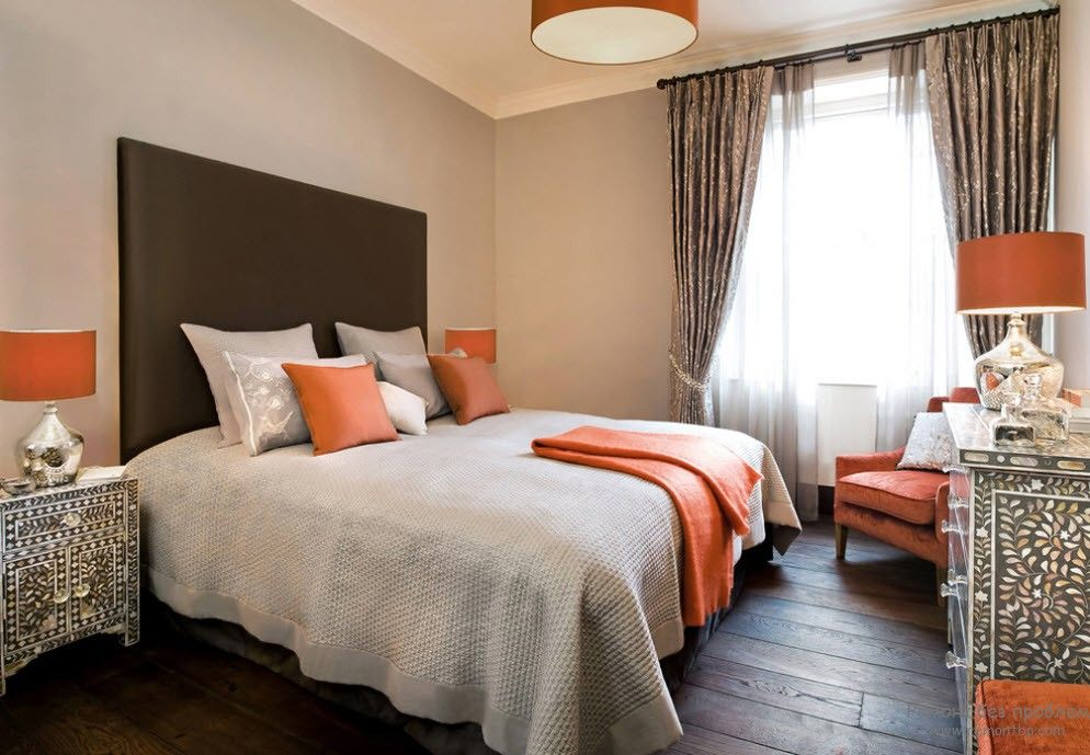 Orange Color Interior Decoration Real Photo Examples. Brown headboard and dark wooden floor in the bedroom