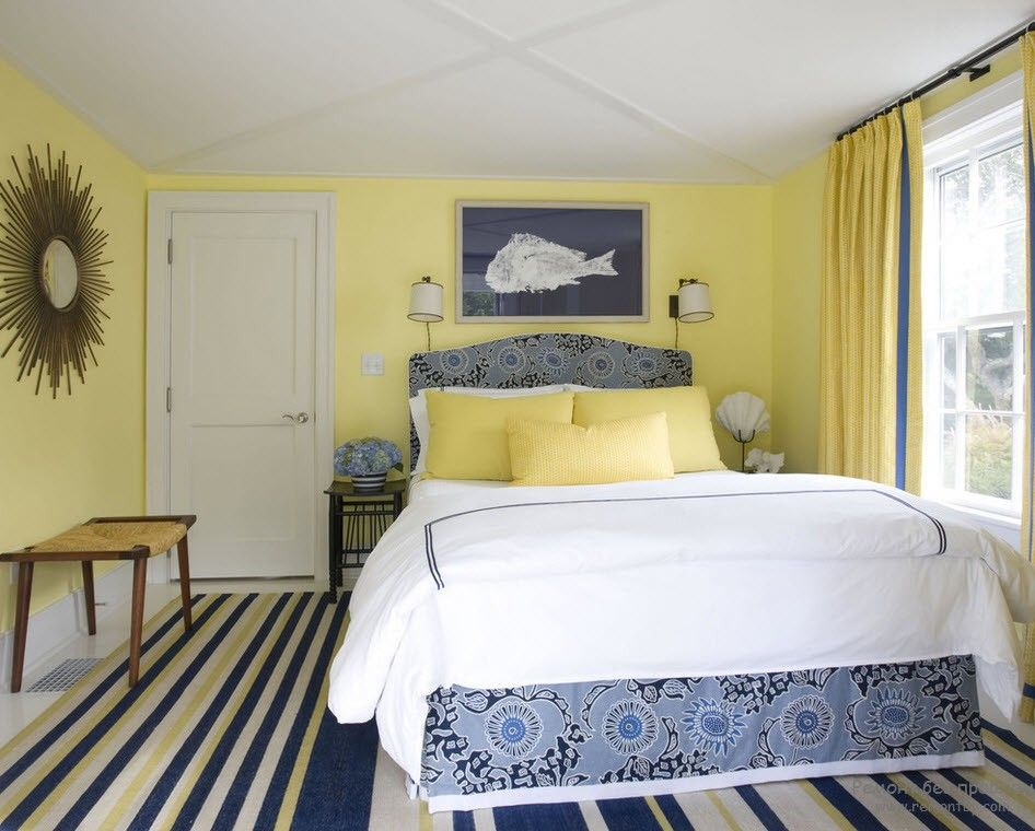 Marine style striped carpeting and the mild yellow walls