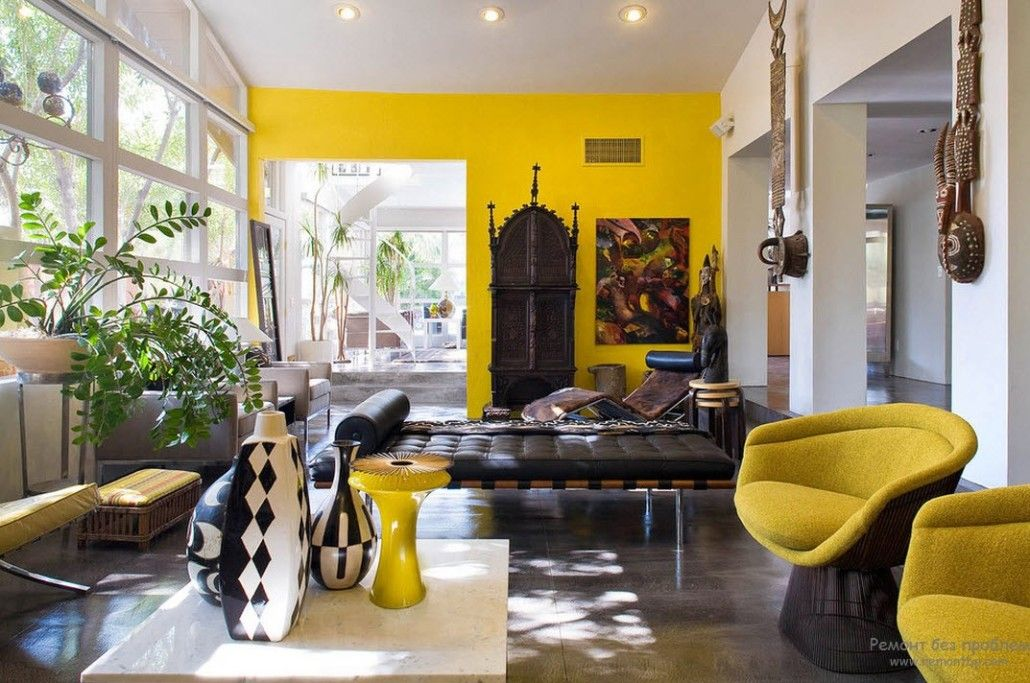 Bright yellow accent wall in African styled living room