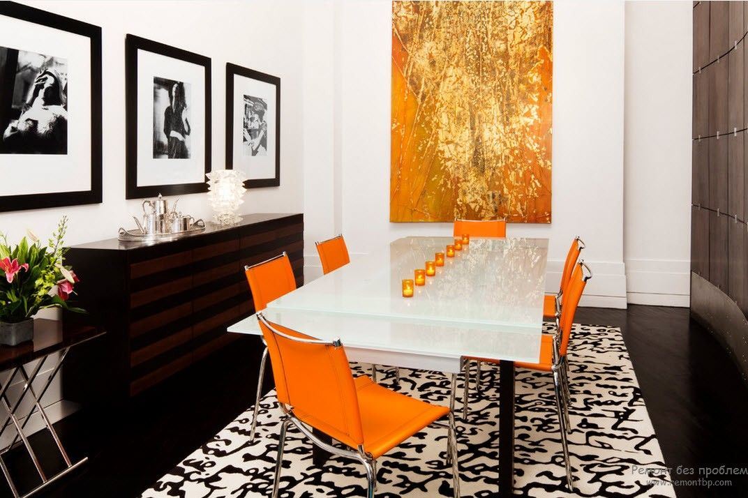 Dining room with the orange set of chairs and white glossy table