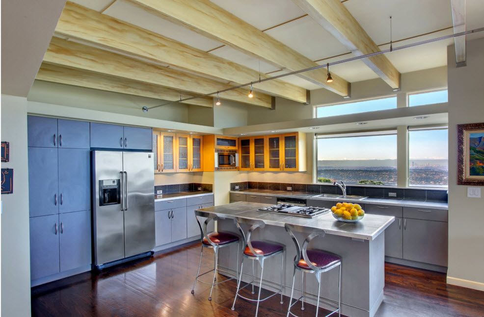 Plane open wooden ceiling beams of light wood in the hi-tech design of the kitchen