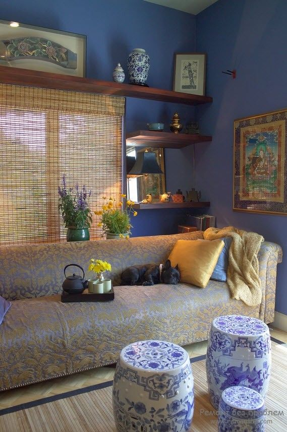 Many of storage systems in the casual styled room with golden pillows on upholstered sofa