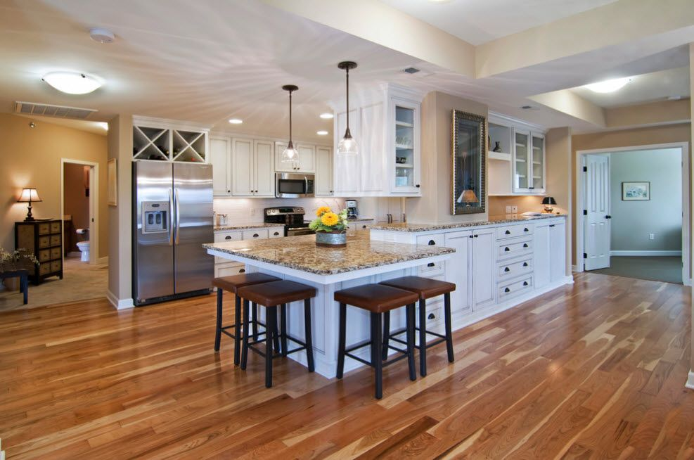 Ultralarge long kitchen studio in the private house with long island and benches