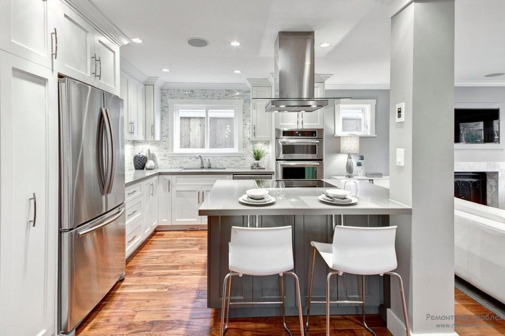 Gray Color Interior Decoration. Simple Elegance for Your Apartment. HI-tech kitchen with futuristic touch and steel color against the natural wooden floor