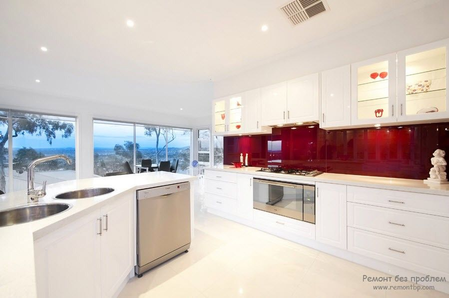 Speckless white glossy large kitchen with the functional island and the cherry colored backsplash