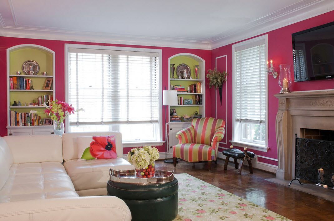 Bold pink painted walls and colorful armchair brings chic into Classic styled living room interior