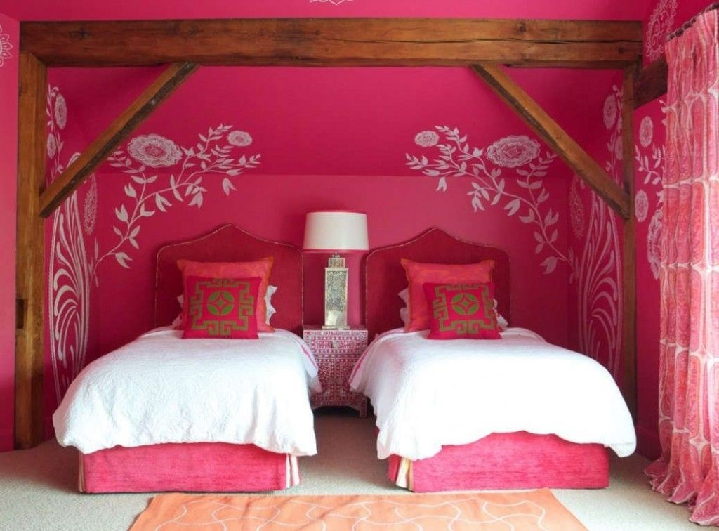 Bold pink girl's room for two with white drawing