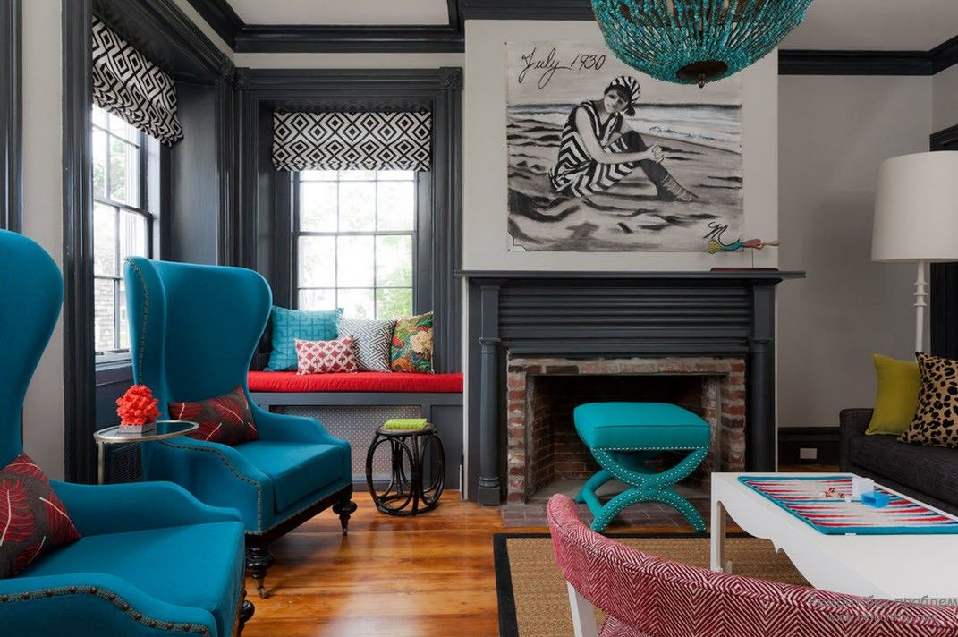 Dark gray Clasic design of the living with the fireplace and turquoise furnishing