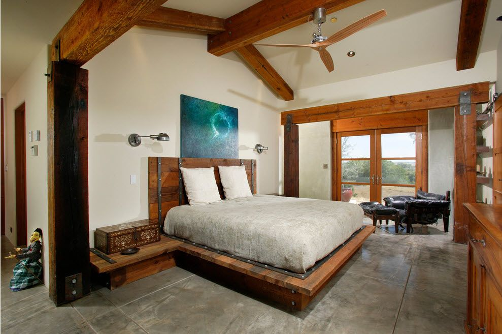 A bit of loft and Mediterranean design styled in the suburban house's white painted bedroom with open wooden beams