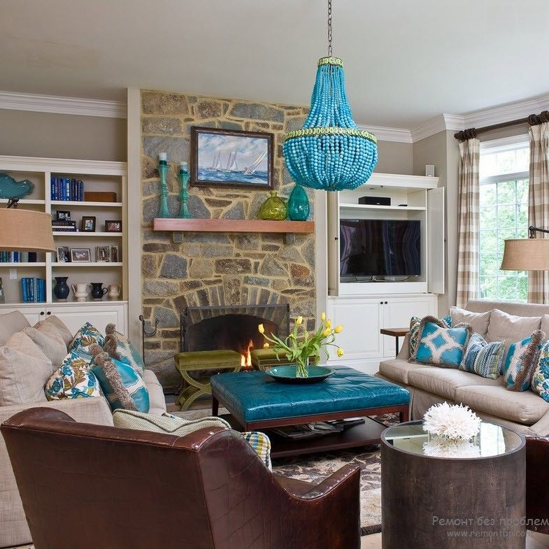 Marine styled room with bright coffe table top and teh turquoise chandelier in the center